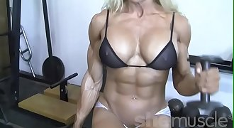 Sexy Blonde Female Bodybuilder In See Through Top Works Out