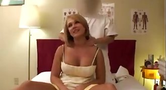 Busty blonde milf enjoys a massage before getting fucked